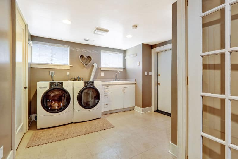 Laundry room that is located in the basement.