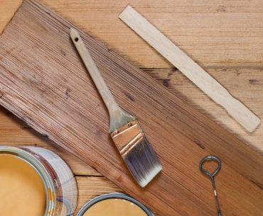 Can you paint over stained wood.
