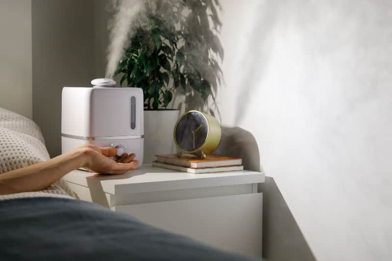 Where to place a humidifier in a bedroom. Should you put it on the floor or the nightstand.