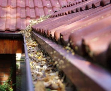 Tips for cleaning rain gutters on a 2-story house.