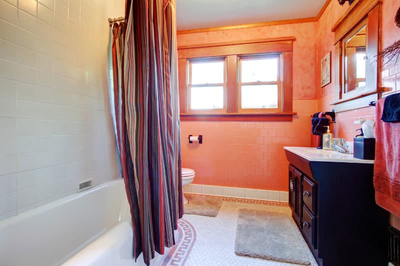 A bathroom with sound absorbent mats, towels, a shower curtain, etc.