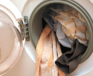 Can you wash sheets and towels with clothes?