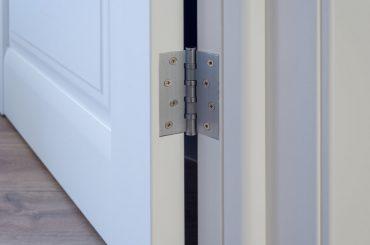 Lubricating squeaky door hinges.