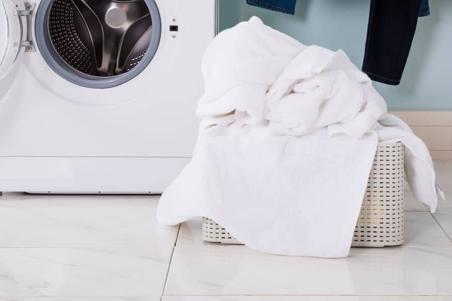 Wash white clothes separately. A pile of white laundry.