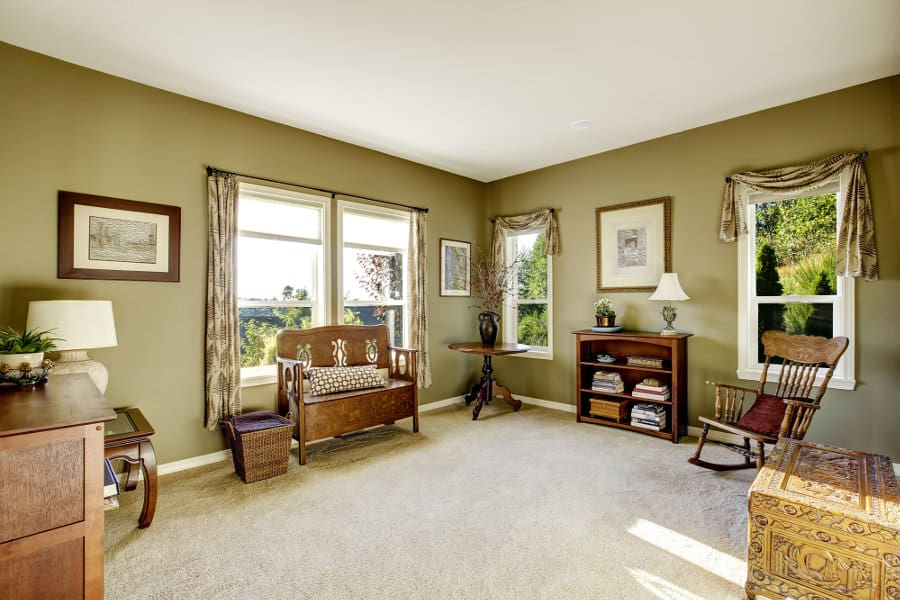 Brown furniture and green walls.