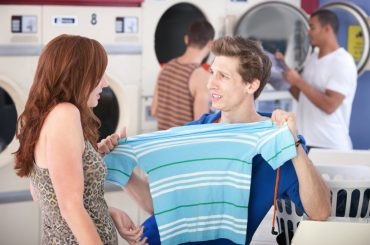 Why do clothes shrink in a washing and drying machine.
