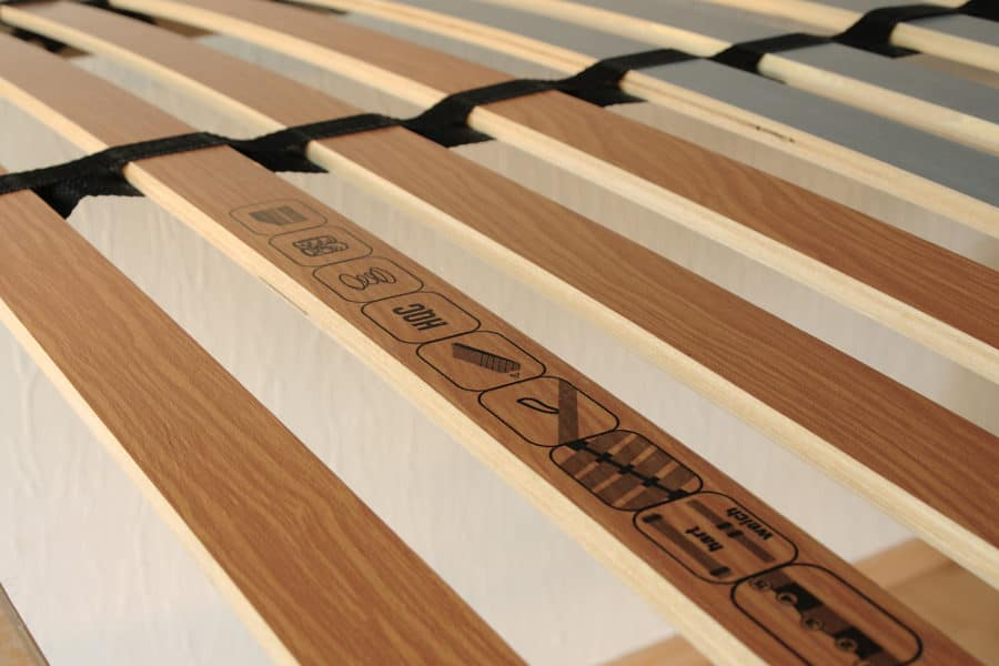 Wooden bed slats as a boy spring alternative.
