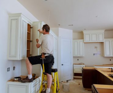 Adjusting old cabinet doors in the kitchen.