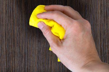 Cleaning and polishing a wooden door (wood door maintenance).