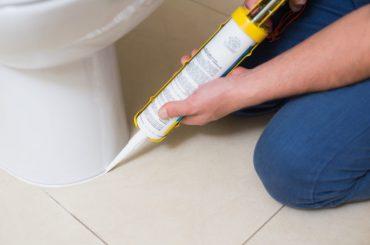 Use silicone caulk around a toilet.