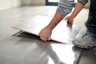 What is the best adhesive for loose floor tiles.
