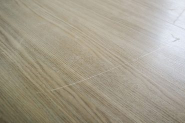How to fix scratches in laminate flooring.