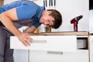 Fixing a sagging drawer bottom.