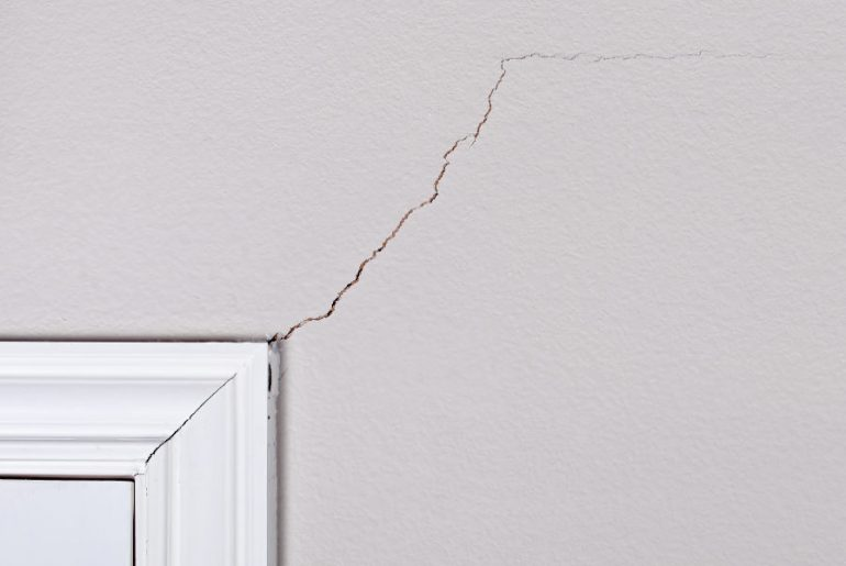 Wall cracks as a result of structural issues.
