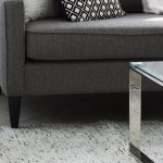 How to stop a couch from sliding: Put a rug under the couch.