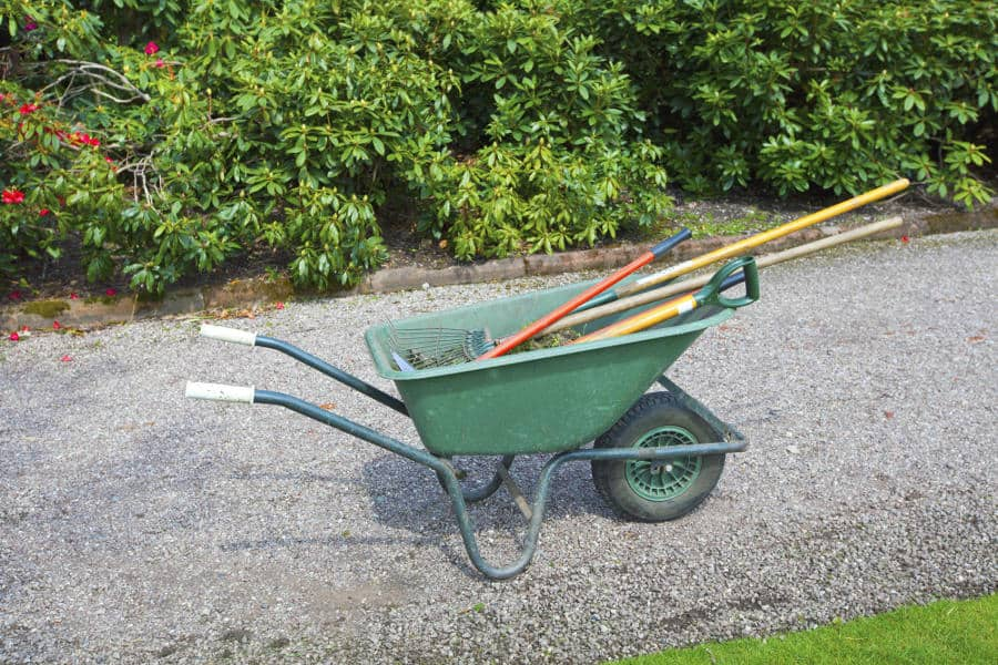 Tools needed to remove rocks from a garden.