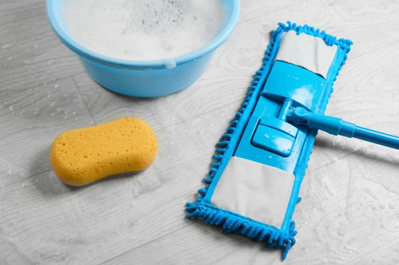 Microfiber mop and liquid cleaner for laminate floor.