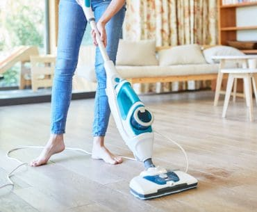 Using a steam mop to clean laminate floors.