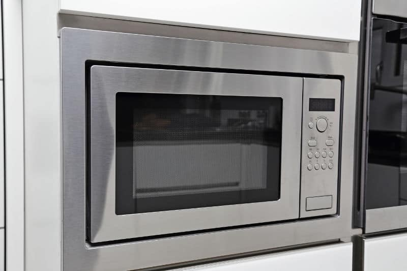 Built-in microwave in a small kitchen.