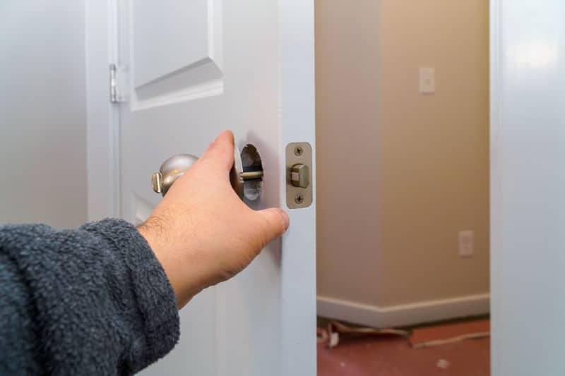 Fixing a doorknob that fell of.