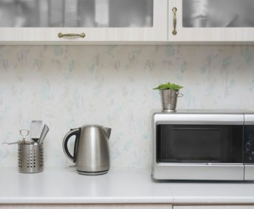 Compact microwave oven in a small kitchen.