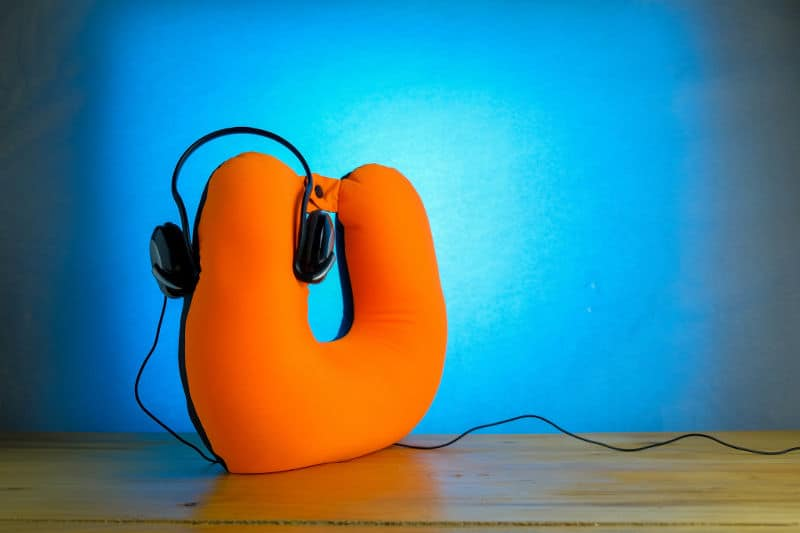Use a travel pillow when you sleep with headphones.