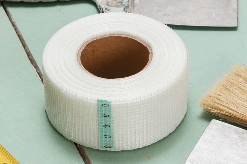 Mesh drywall tape for repairing bigger cracks.