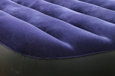 Fixing a hole in an air mattress seam.