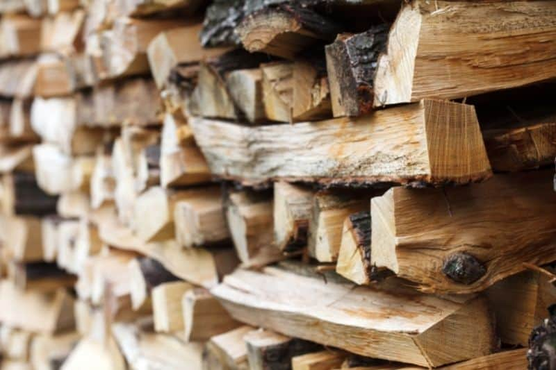 Stacking firewood for maximum airflow.