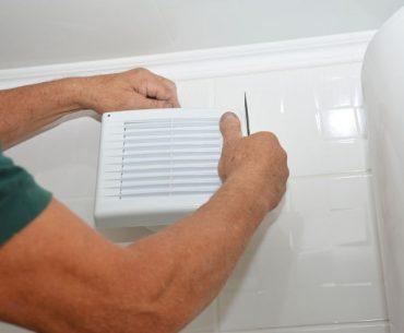 Repairing a noisy bathroom exhaust fan (ventilation).