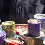 Disposing of old paint and cans. Taking paint cans to a recycling center.