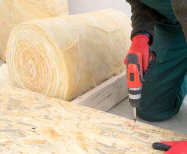 Installing floor insulation.