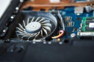 A dusty laptop fan making a buzzing noise.