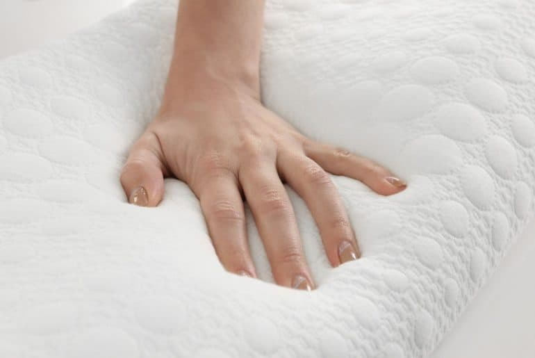 Softening a stiff memory foam pillow.